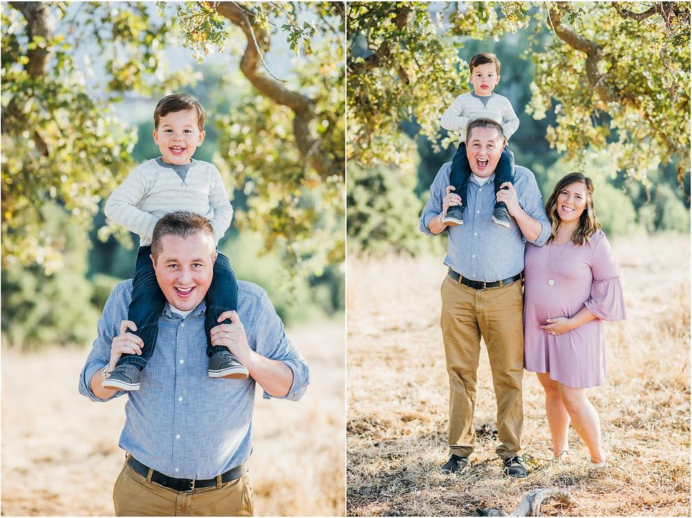 Little boy on dads shoulders under oak tree in Northern California