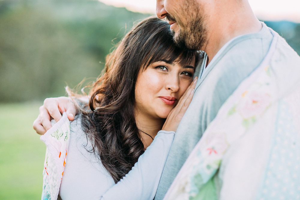 Wife leaning on husbands chest in Palo Alto for family photographer