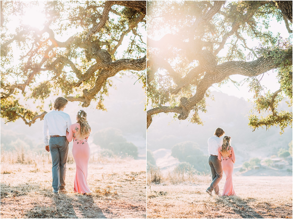 Pregnant mom wearing pink ASOS dress under oak tree in Los Altos for maternity photography