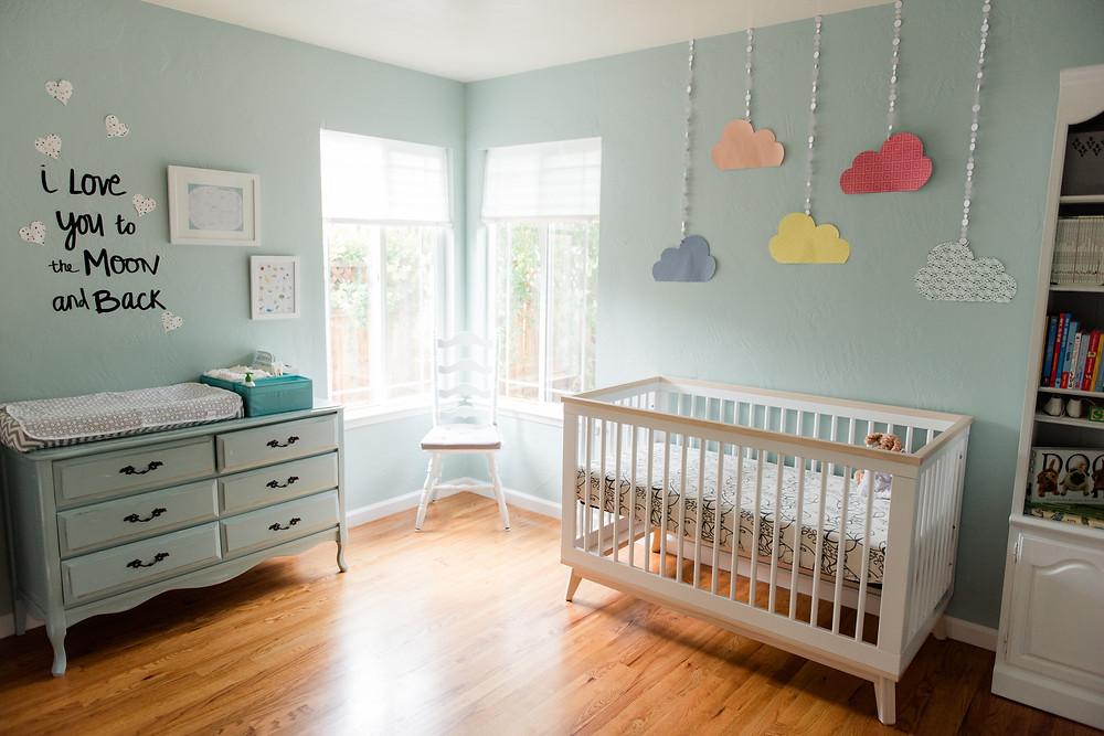 Mint green nursery in San Jose with handmade details