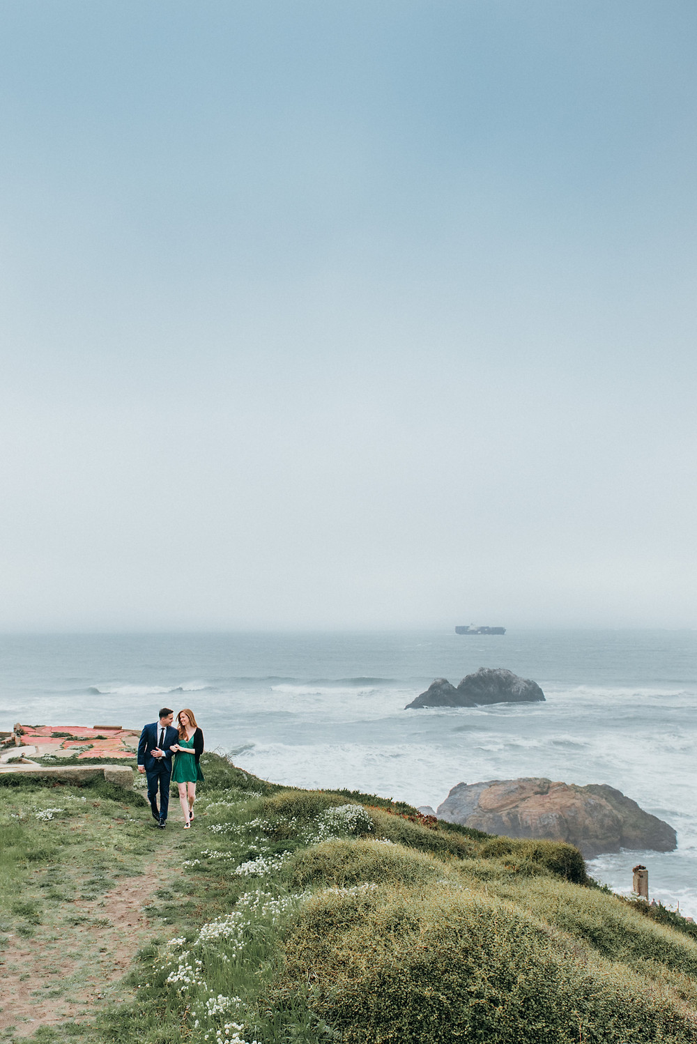 Couple walking on bluff in San Francisco for maternity pictures