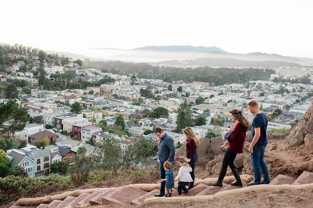 Family walking away from camera at Twin Peaks in San Francisco