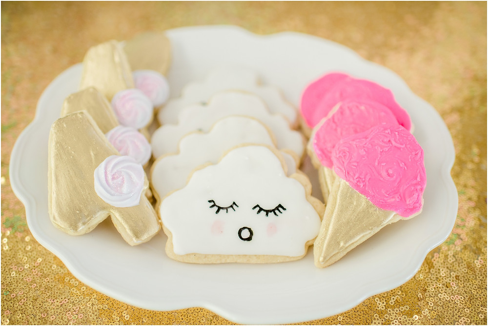 Cloud and cotton candy cookies on gold table cloth for Unicorn party