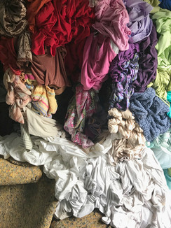 It's Always Now (detail), 2018, Site-specific Installation with clothes, carpet padding, wood.
