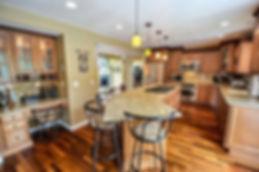 Kitchen-Remodeled-Granite-Hardwood.jpg
