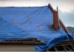 blue-tarp-covering-roof.JPG