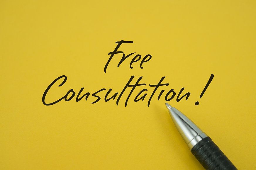 Free Consultation! note with pen on yell