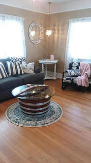 Living room with half barrel table.jpg