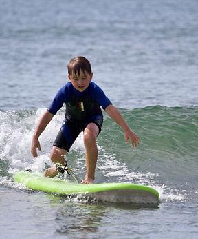 henry-surf-lesson_43706548694_o-min.jpg