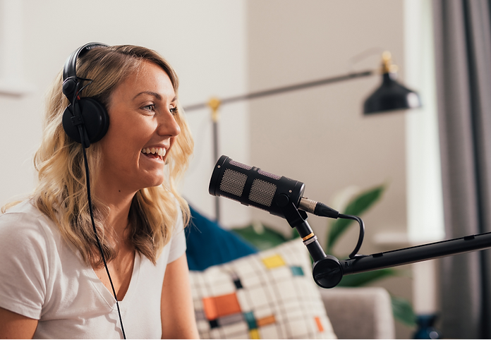 Picture of girl with headphones podcasting using the Sontronics Podcast Pro Black microphone in living room setting