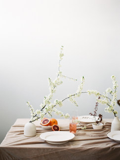 Organic sprin table setting with blooming branches | Nord & Mae