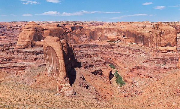View of confluence of Coyote Gulch and Escalante River from Crack in the Wall with Stevens Arch