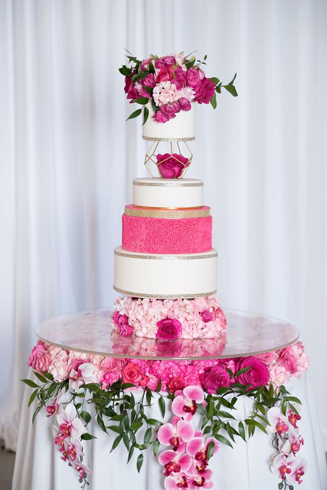 Flower filled cake table with beautiful hanging Phalaenopsis Orchids