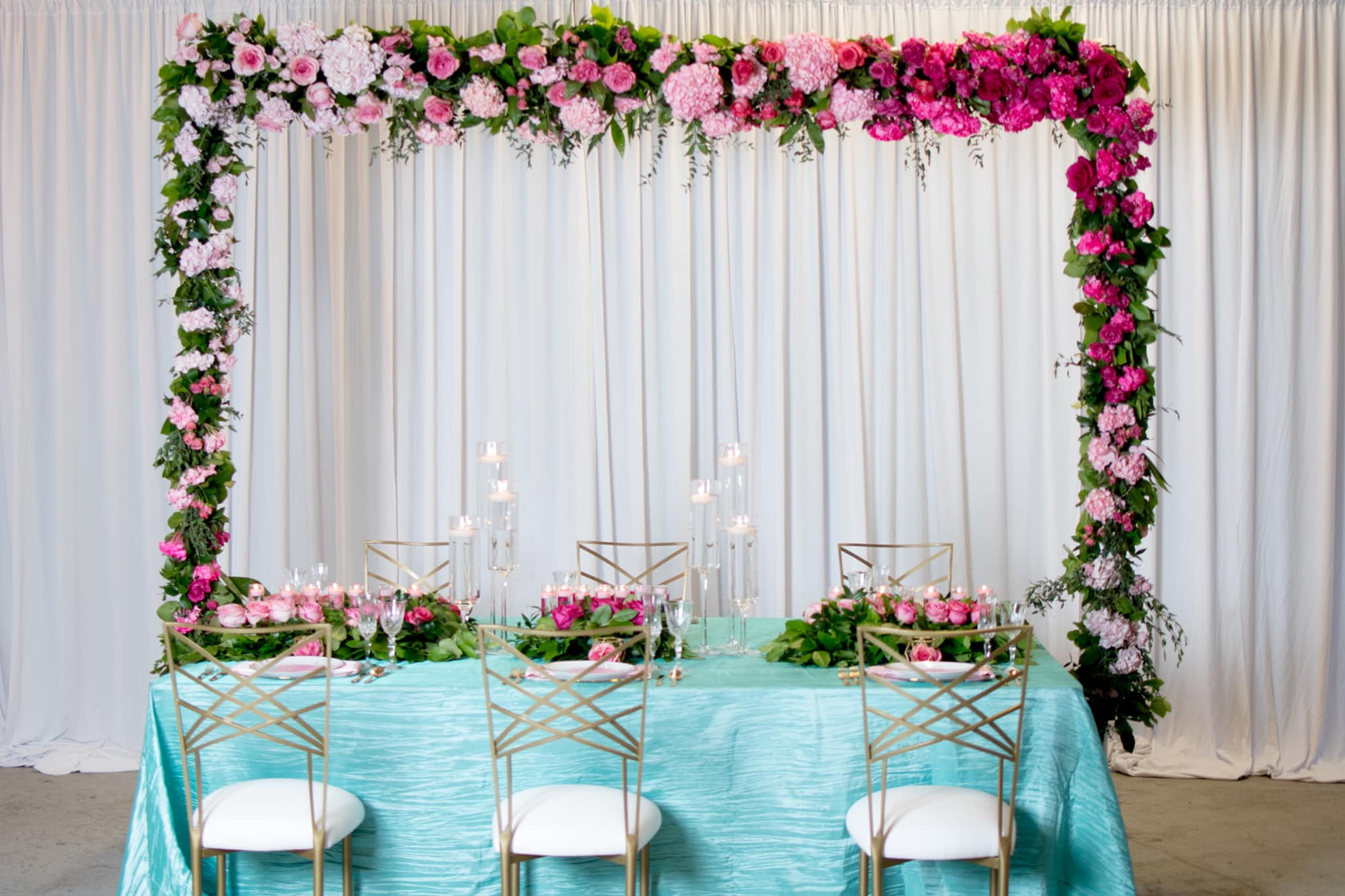 Overhead pink ombre' floral arch