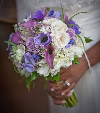 Bride's hand-tied bouquet in shades of lilac and lavender.