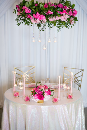 Floral chndelier over a simply elegant sweetheart table