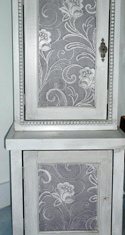 Raised lace stencil on cabinet