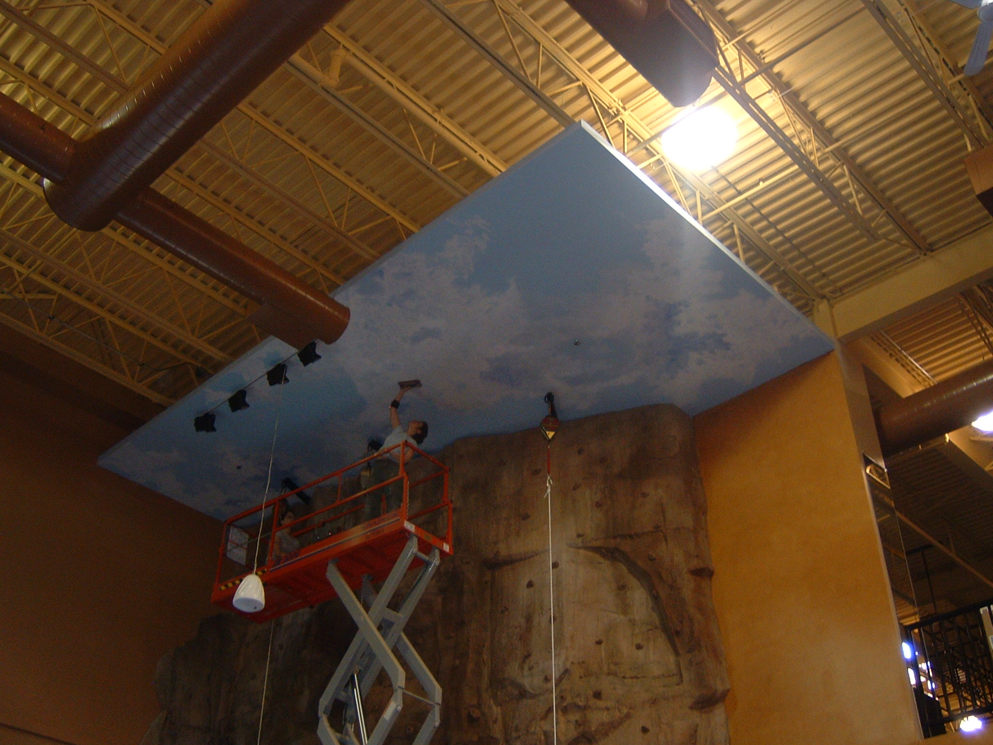 Painting ceiling at XSport Fitness
