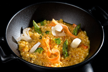 Brown rice paella with vegetables and ga