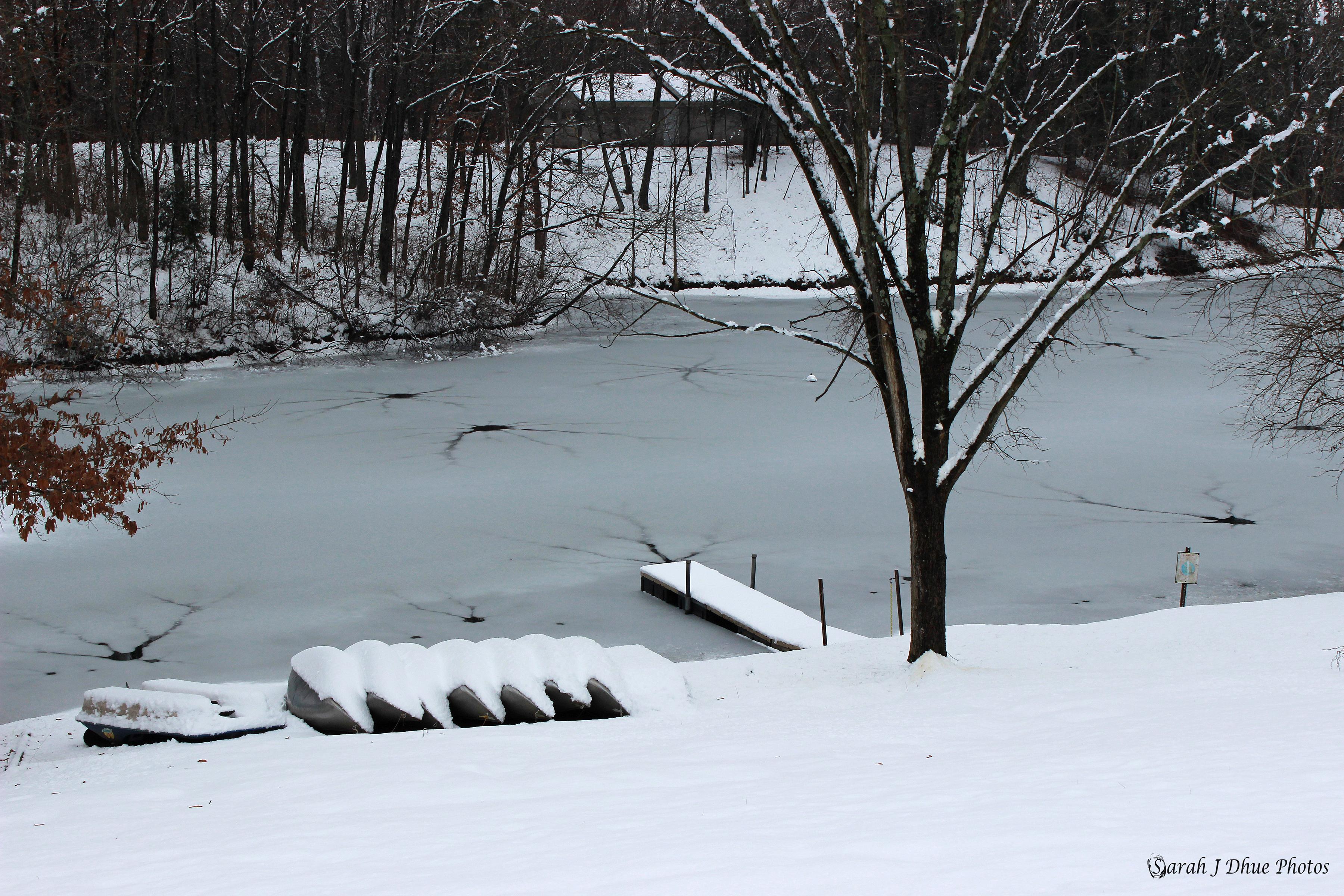 Frozen Lake & Canoes