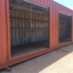40' Roll Up Door container with shelving, great fireworks stands or set up for jobsite materials.