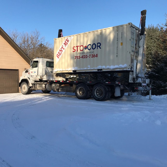 20' Storage Container Rental in Winter residential area for moving and storage