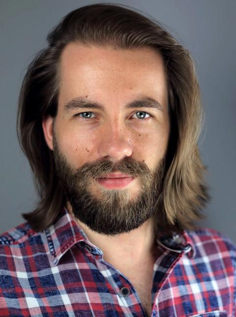 Geoffrey Alkemade headshot longhair + beard + smile.jpg