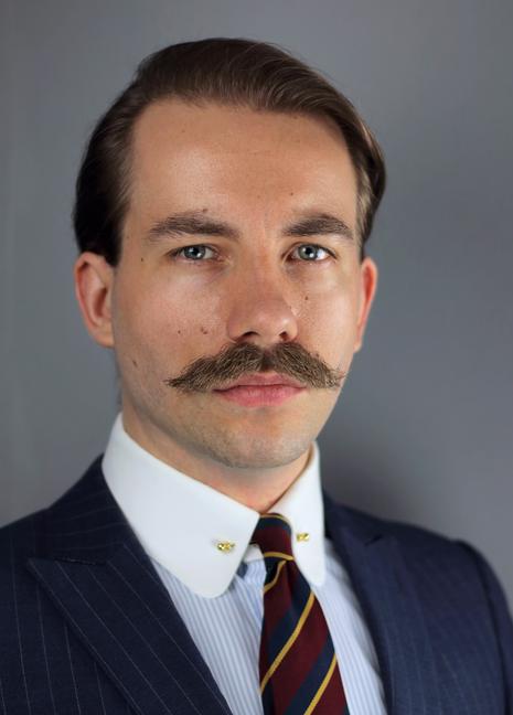 Geoffrey Alkemade headshot mustache
