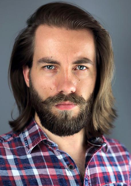 Geoffrey Alkemade headshot long hair+beard.jpg