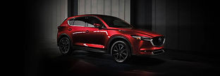 red-Mazda-CX-5-parked-in-shadowy-garage_