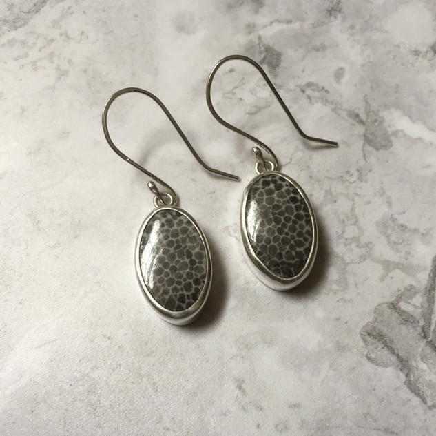 Fossilised black coral earrings