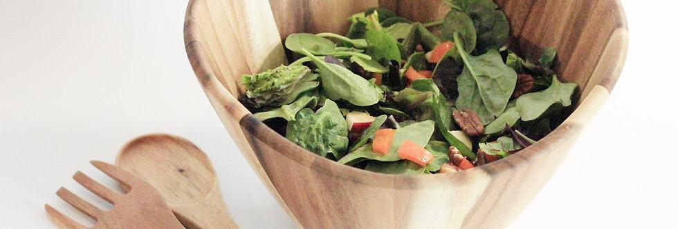Hand carved salad bowl with serving utensils