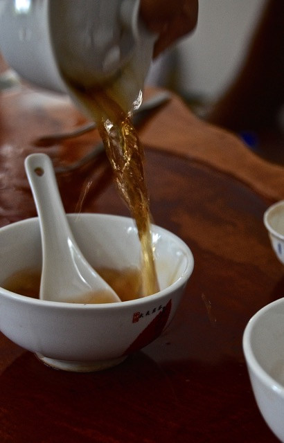 A first sip when arriving of the local specialty tea is always vital. Here a cup of Da Hong Pao is served up.