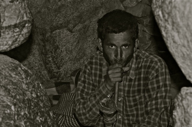 Habits die hard for shepherds who've no one to love but their herds. Here an old fashioned hooka...one that is used