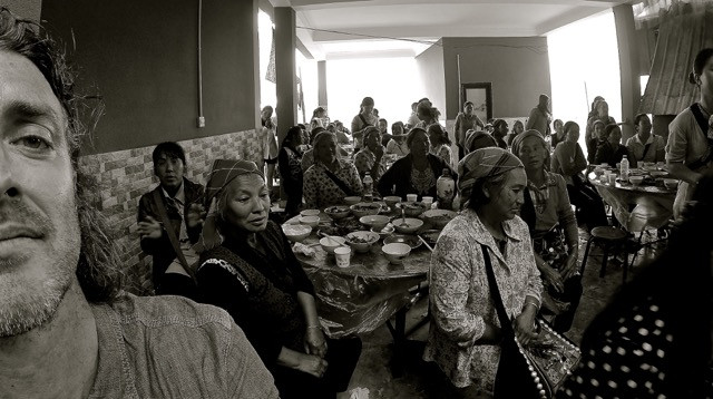 Han women sit wrapt with local music after a meal.