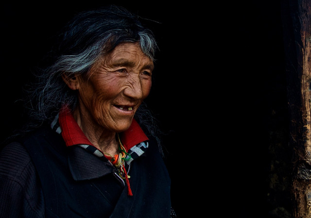 """""""Why have you come all this way to these lands. How did you arrive""""? Our little team burrowed into this warm woman's home that she shared with her ailing husband near Yading in western Sichuan Province. Within minutes this family who had little shared everything they had, and this woman Kersang proceeded to ask questions as though she knew that many outside mysteries would be revealed in this fleeting moment. She laughed and apologized for the acrid smoke being puffed out by her little stove and she spoke about the land. """"It is all we have so we must care for it. It is family"""". I'd never heard this reference before, but imagine a world where her logic of the land being family prevailed."""