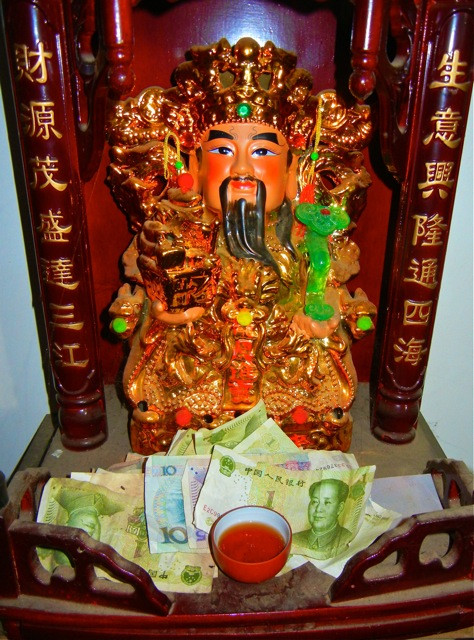 Even the gods require tea. A deity and place of worship with cash and a single cup of tea shows the priorities of worship in southern Yunnan