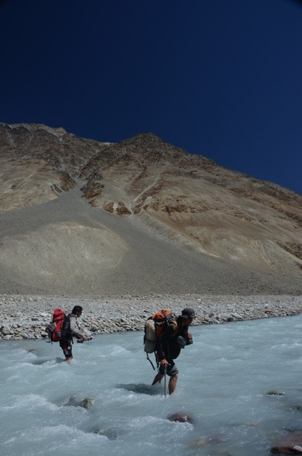 Crossing glacial rivers becomes something regular.