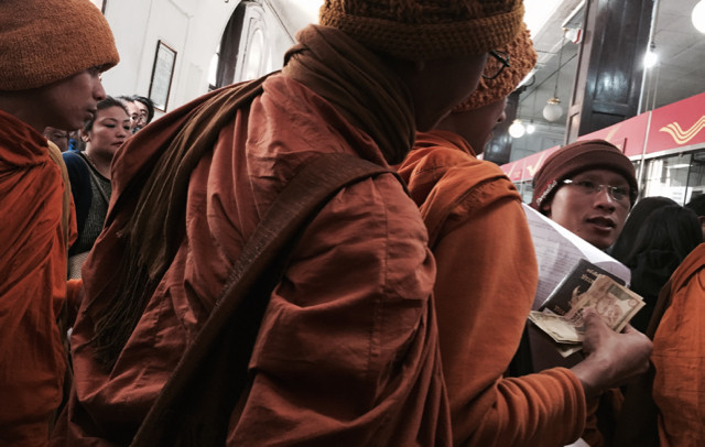 An outtake...when in Darjeeling, the demonetization of the Rupee hit. Here a shot of some Thai monks in the local post office trying to change money...along with a mob of us trying to offload our big bills.