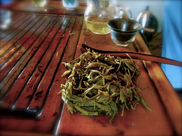The end result of a good session of slurping in Menghai: the leaves that gave delight, lie bare on a tea table