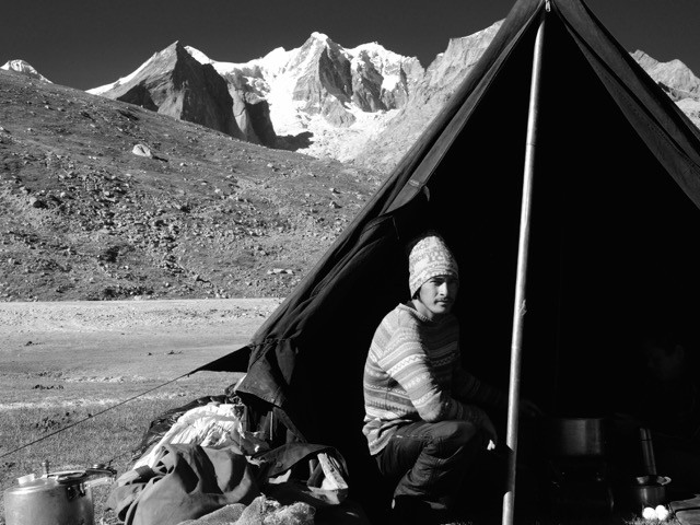 Kamal in the famed kitchen tent with the snow peaks behind that line Bara Shigri