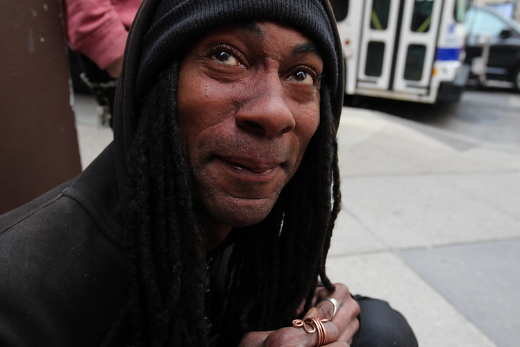 """Williams, 47, sits on the corner of Broad and Chestnut Street in Philadelphia on May 7, 2017. He averages around five sales each day, which is enough to pay his rent. """"A lot of people out here, they think I'm homeless,"""" he said. """"I'm not. I do this because I love it."""""""