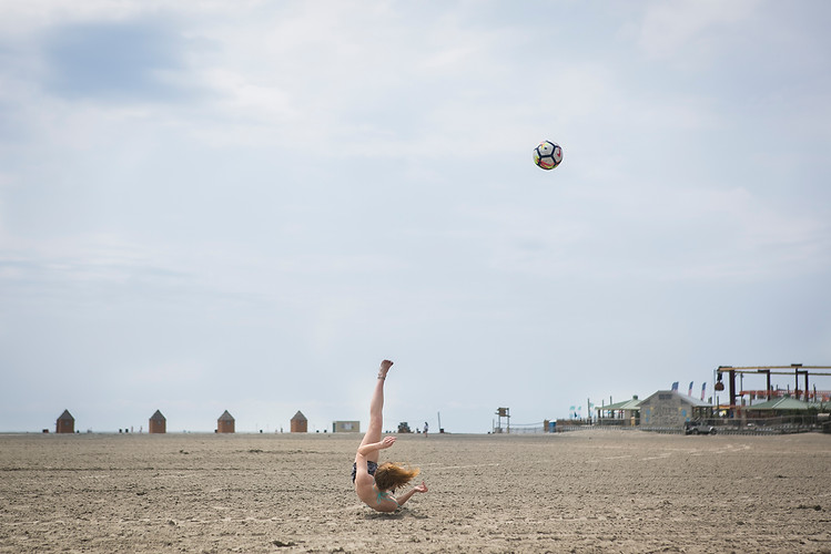 Caitlyn Mullins, 19, plays soccer on the beach in Wildwood, N.J., on the morning of Thursday, July 12, 2018. Maggie Loesch / The Philadelphia Inquirer