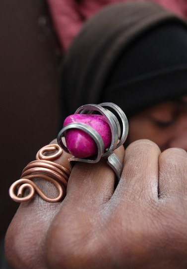 Williams shows off a ring he has just created from a fork and a fuschia stone (right).