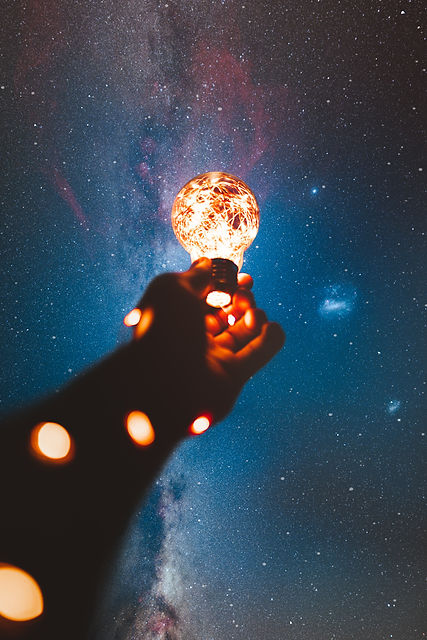 person-holding-light-bulb-with-string-li