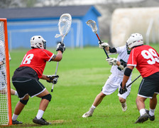 Lacrosse goalie protecting the net durin