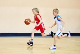 Girl and boy athlete in sport uniform pl