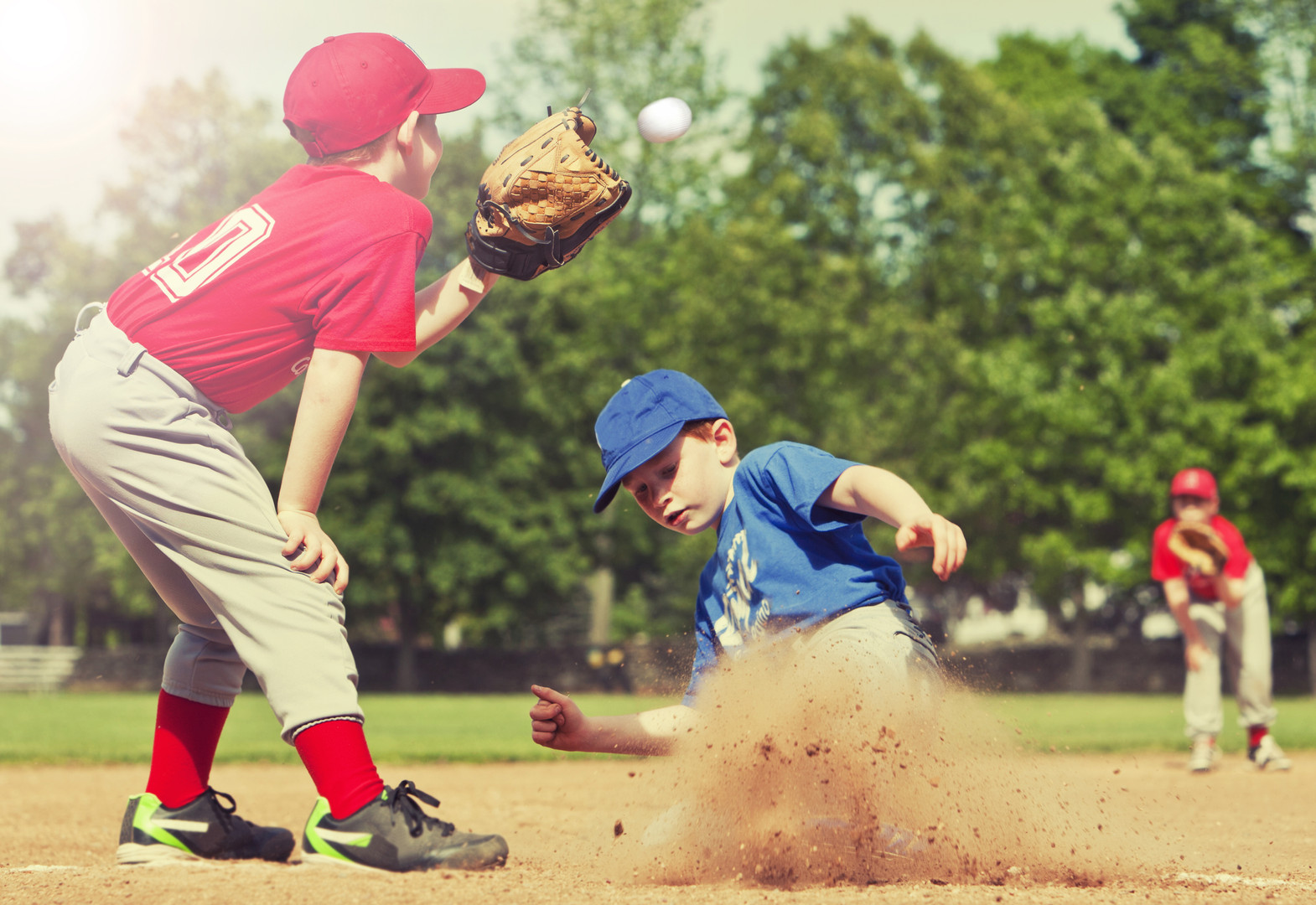 Boy sliding into base during a baseball