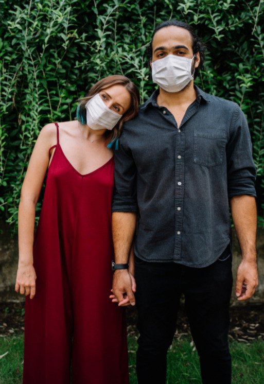 A cute couple with face masks