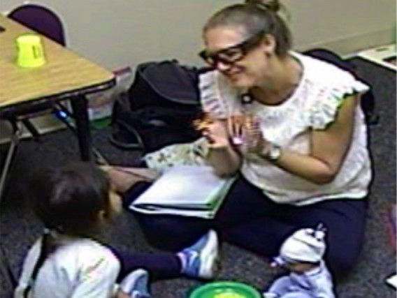 Clinician interacting with a child during assessment for autism